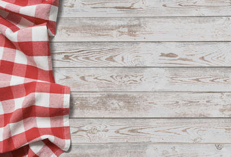 red folded tablecloth with white wooden table