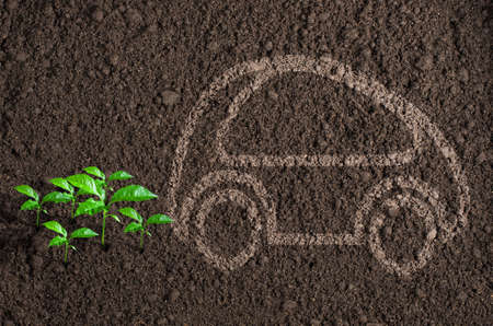 ecology car silhouette with green sprouts instead of exhaust 版權商用圖片