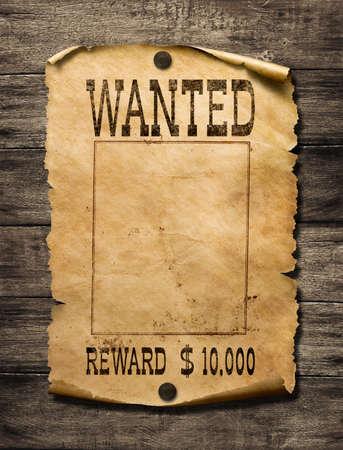 Wilde westen poster op houten muur gezocht Stockfoto