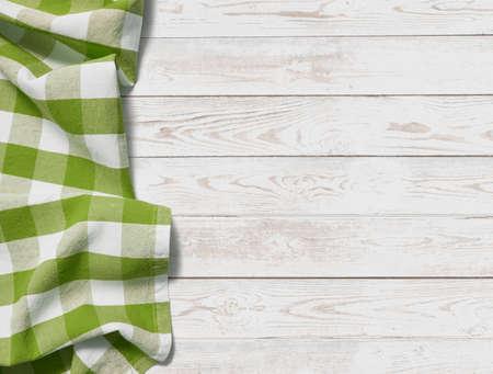 Tisch mit grasgrünem Picknicktuch Draufsichthintergrund Standard-Bild