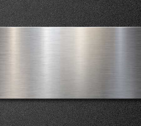 Brushed steel or aluminum metal panel over plastic background Stock Photo
