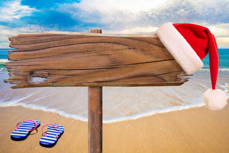 Christmas beach party signboard as background for text 免版税图像