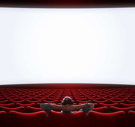 Blank movie screen with lonely man sitting in center. 3d illustration. Reklamní fotografie