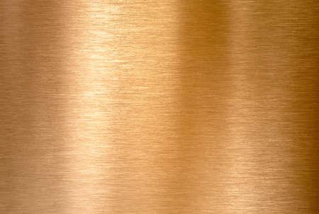 Fondo o struttura del metallo spazzolato rame o bronzo Archivio Fotografico