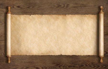 old scroll or parchment on wooden desk