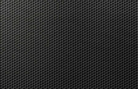 Black metal perforated grid background