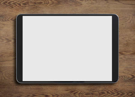 Black tablet pc on old wood table oriented horizontal