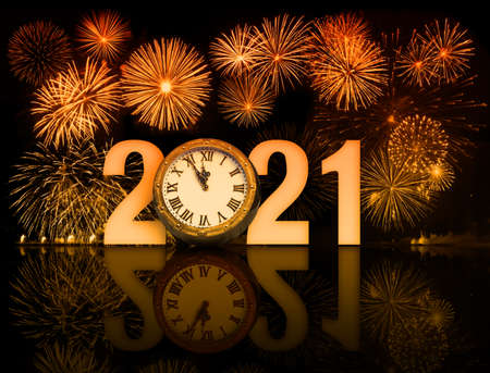 new year 2021 fireworks with clock face