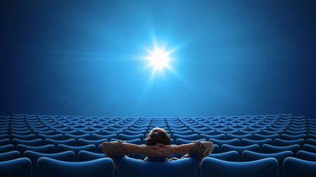 Cinema with person sitting in center 16:9 format Standard-Bild