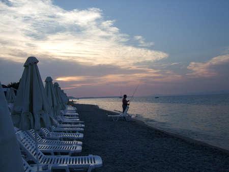 Beautiful sunset on the beach. The Aegean coast. Summer photo