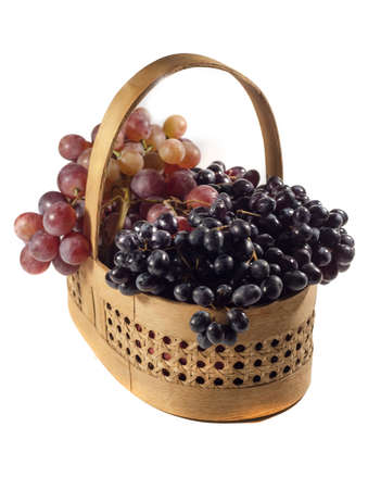 basket with white and red apples and grapes photo