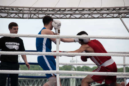 knockdown: St. Petersburg, Russia, JUNE 12: A boxing match at a tournament in honor of Independence Day June 12, 2015, in St. Petersburg, Russia. Editorial