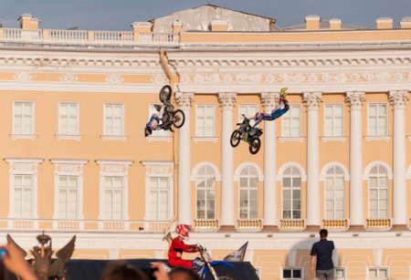 motosport: Sankt-Petersburg, Russia - Jule 04, 2015: two motorcyclists performing a jump on a bike, in St. Petersburg, Jule, 2015, Russia Editorial