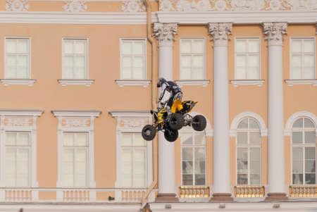 jule: Sankt-Petersburg, Russia - Jule 04, 2015: the athlete performs a dangerous jump on a motorcycle, in St. Petersburg, Jule, 2015, Russia