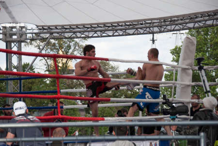 muffle: St. Petersburg, Russia, JUNE 12: A boxing match at a tournament in honor of Independence Day June 12, 2015, in St. Petersburg, Russia. Editorial