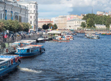 piter: boats Moored on the embankment of the Fontanka river in St. Petersburg, Russia.