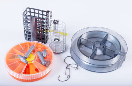 feeders: Accessories for fishing. Fishing lines, hooks, sinkers and feeders Stock Photo