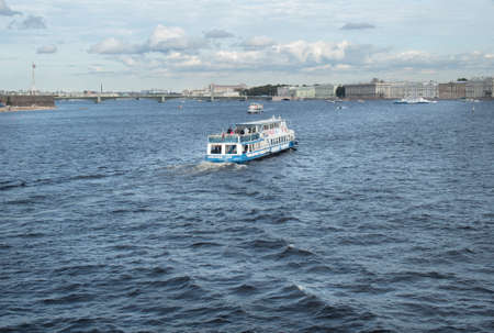 piter: Saint Petersburg, Russia September 10, 2016: Excursion boat with tourists floats on the Neva river in St. Petersburg, Russia.