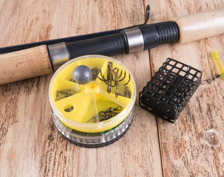 sinkers: fishing accessories. Spinning, feeder, round boxes, hooks and sinkers Stock Photo