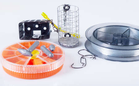 sinkers: Accessories for fishing. Fishing lines, hooks, sinkers and feeders Stock Photo