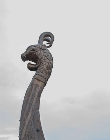 Nose Viking warship at a shadow in the background of cloudy sky Stock Photo