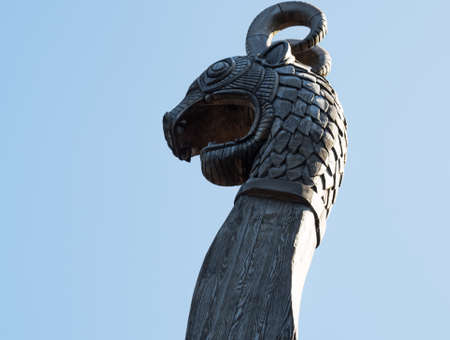 Fragment of the nose of a medieval viking ship against the blue sky Stock Photo