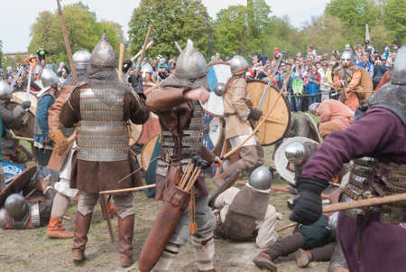 St. Petersburg, Russia - May 27, 2017: Demonstrative historical battle on the ancient weapons. Historical reconstruction of sword fighting in St. Petersburg, Russia Editorial