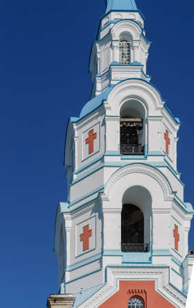 Belfry in a Christian monastery against the blue sky. Spaso-preobrazhenskiy Cathedral  Stock Photo