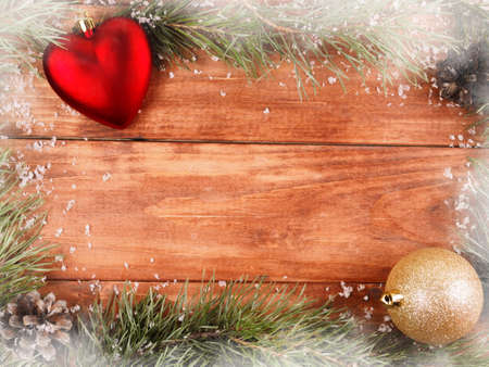 Background of fir branches and cones on a wooden background Stock Photo