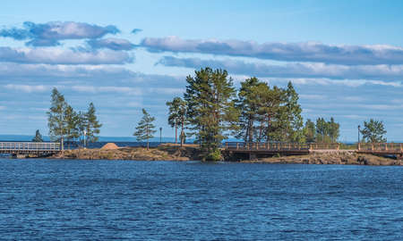 Island with observation bridge on Lake Ladoga Stock Photo