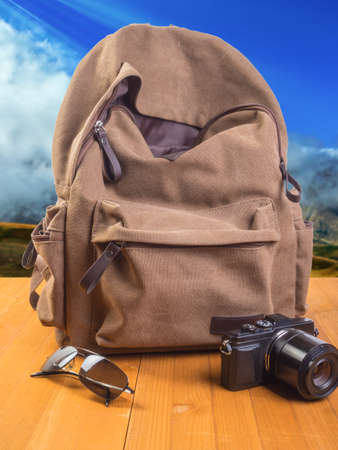 Background for travel. Backpack, glasses and camera
