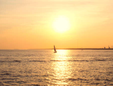 Sailing boat in the sunset of the Gulf of Finland