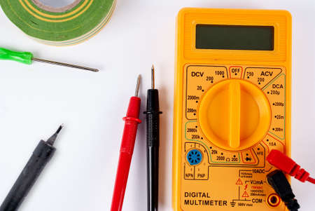 Multimeter, soldering iron and screwdriver on a white background Banco de Imagens - 132233111