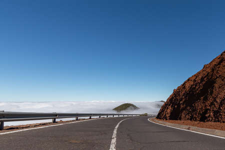 Winding mountain road above the clouds on the island of Tenerife