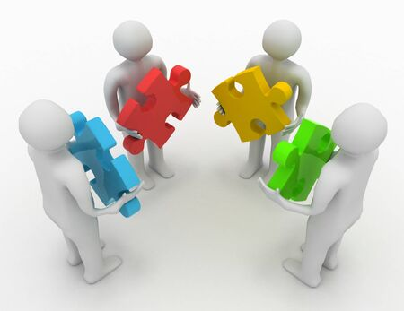 teamwork concept, four persons with different puzzles Standard-Bild