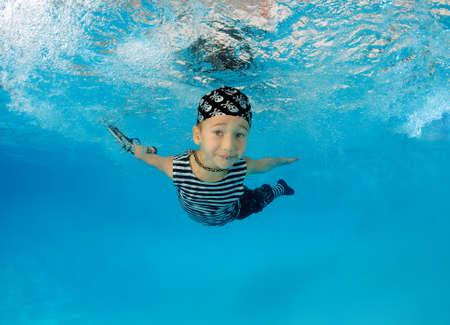 fair skinned: Boy presenting underwater fashion in pool Stock Photo