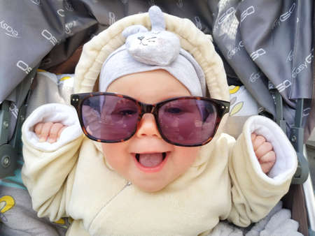 Funny face of happiness baby girl laughing in sunglasses. Cute baby with sunglasses 写真素材