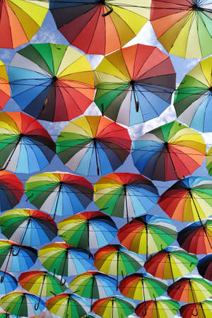 Colorful umbrellas background. Lots of umbrellas coloring the sky in the city of Odessa, Ukraine. Street decoration 写真素材
