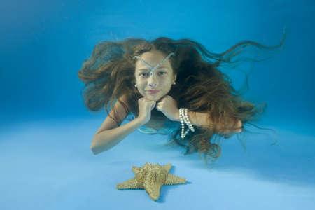 The girl lies underwater. underwater girls pictures