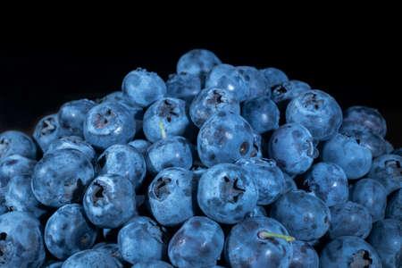 Close up of Bog bilberry, bog blueberry, northern bilberry or western blueberry (Vaccinium uliginosum) on black background. Reklamní fotografie