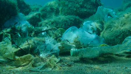 Close-up of the seabed covered with a lot of plastic garbage. Bottles, bags and other plastic debris on seabed in Adriatic Sea. Plastic pollution of the Ocean Reklamní fotografie