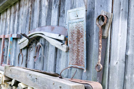 old tools: Old tools on wooden wall of a barn