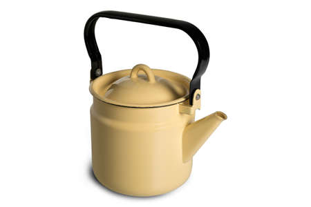 Yellow metal kettle on an isolated white background Stock Photo