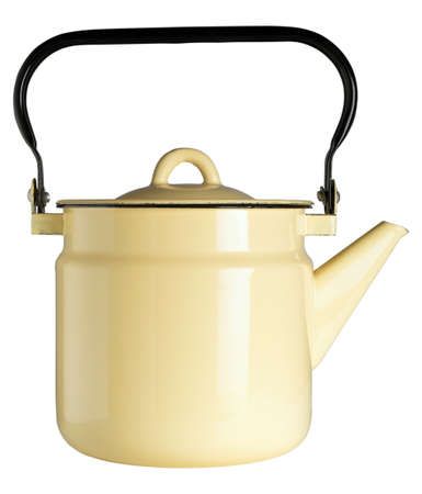Yellow iron kettle on a white isolated background Stock Photo