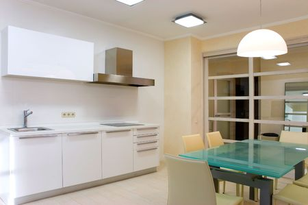 spaciousness: Modern kitchen with furniture