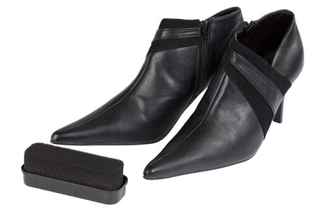 blacking: Two shoes and cleaner on the white background as care conception Stock Photo