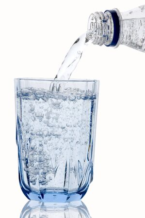 carbonic: Mineral water in the blue glass and bottle