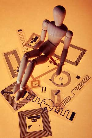 vertical image: Dummy on RFID tags, orange background Stock Photo
