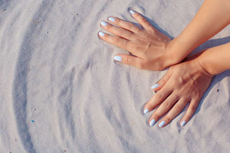 white sand: Female hands playing in white sand Stock Photo