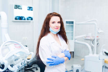 dentistry student standing in a dental treatment room Stockfoto